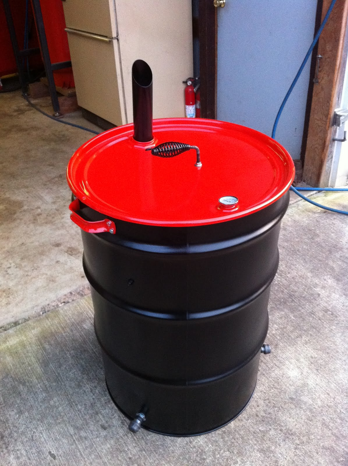 55 Gallon Drum BBQ Grill http://sengook.com/55-gallon-smoker-grill.html